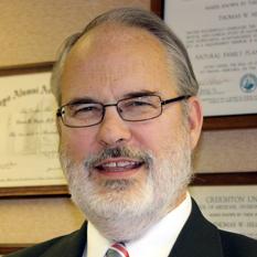 Dr Thomas W. Hilgers